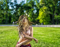 Girl with zizi cornrows dreadlocks dancing on lawn Stock Image