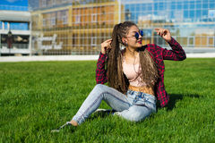 Girl with zizi cornrows dreads listening to music Royalty Free Stock Photography