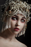 Girl zombie with beautiful vintage decorated hat stock photography