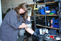 Girl3. Hard working girl at work in a garage.Looking at you Stock Images