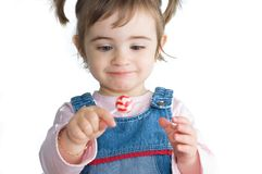 Girla and candy. Happy girl holding a candy lolipop Royalty Free Stock Photo