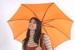 Girla and umbrella. Pretty girl with orange umbrella in her hand Stock Images