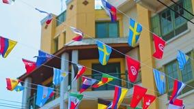 Girland av flaggor på en stadsgata stock video