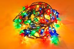 Girland av kulöra lampor för julgranar Royaltyfria Bilder