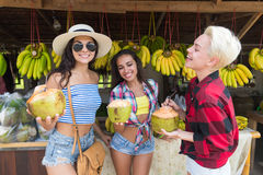 Girld Group Drick Coconut Cocktail Asian Fruits Street Market Buying Fresh Food, Young Friends Tourists Exotic Vacation Royalty Free Stock Image