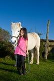 Girld with a white horse. Stock Photos