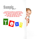 Girle beside a white blank with sample text Stock Photography