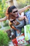 Girlfriend. Two girlfriends enjoyed a successful shopping Stock Photography