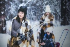 Girlfriend beautiful young women dressed warmly in winter Park stock photo