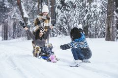 Girlfriend beautiful young women dressed warmly in winter Park royalty free stock photography