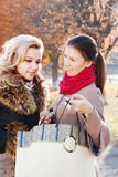 Girlfriend boast shopping. Beautiful girlfriends smile and brag about shopping Royalty Free Stock Photo