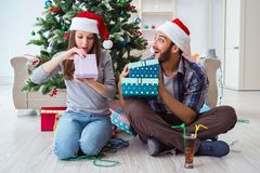 The girlfriend and boyfriend opening christmas gifts Royalty Free Stock Photos