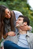 Girlfriend and boyfriend smiling outdoors. Royalty Free Stock Photos