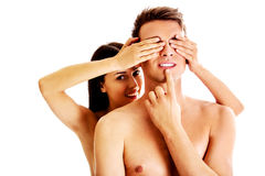Girlfriend covering the eyes of her boyfriend for a surprise - isolated Royalty Free Stock Image