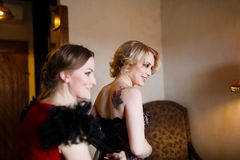 Girlfriend dressing up the bride Royalty Free Stock Images