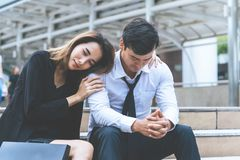 Girlfriend forgive and hugging an upset boyfriend outdoor. Girlfriend is forgive and hugging an upset boyfriend outdoor stock image