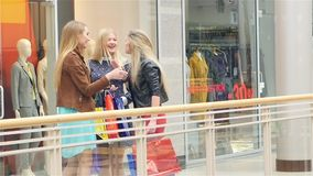 Girlfriend found on shopping, hugging, kissing. Unexpected meeting friends for shopping,  girls are very happy to see each other. Close-up. Slow motion stock video