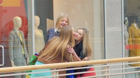 Girlfriend found on shopping, hugging, kissing. Unexpected meeting friends for shopping,  girls are very happy to see each other. Close-up. Slow motion stock footage