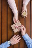 Girlfriend gifting postcard in envelope and present box to boyfriend Royalty Free Stock Photography