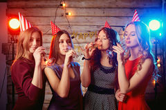 Girlfriend girls at the birthday party drinking champagne royalty free stock photo