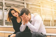 Girlfriend giving Consolation to a stressed boyfrined office. Girlfriend is giving Consolation to a stressed boyfrined office stock photos