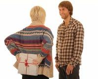 Girlfriend giving man present Stock Photo
