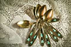 Girlfriend. Gold plated spoons, dishes,white tablecloth,tea,decor,turquoise flowers,lace,house Stock Photos