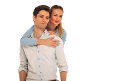 Girlfriend holding man from behind Royalty Free Stock Images