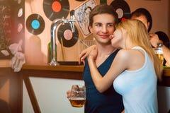 Girlfriend hug her boy in bar Royalty Free Stock Photography
