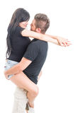 Girlfriend jumping on boyfriend arms Stock Image