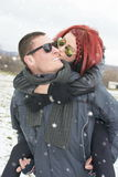 Girlfriend kissing a boyfriend on the cheek Stock Images