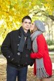Girlfriend kissing her boyfriend Royalty Free Stock Image