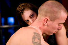 Girlfriend kissing her boyfriens neck Royalty Free Stock Photo