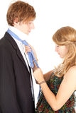 Girlfriend knotting the necktie hers boyfriend Royalty Free Stock Images