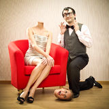 Girlfriend loses her head in love marriage proposal of self confident nerd man boyfriend for valentine day Stock Photo