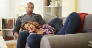 Girlfriend lying on boyfriend's lap Royalty Free Stock Photography