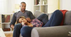 Girlfriend lying on boyfriend's lap Stock Images