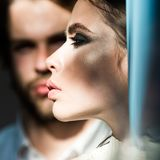 Girlfriend with makeup face skin with blurred boyfriend on background. Couple in love. Fashion, beauty, look, make up. Love, romance, relations, family royalty free stock photos