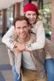 Girlfriend piggy-backing on her boyfriend Stock Photo