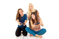 Girlfriend play video games. Friends play video games isolated Stock Image