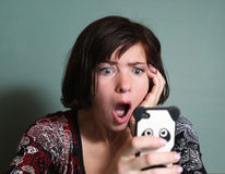 Girlfriend read all over sms from boyfriend Stock Photos