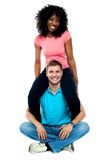 Girlfriend riding on her mans shoulder Royalty Free Stock Photos