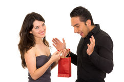Girlfriend surprises boyfriend with a gift Royalty Free Stock Image