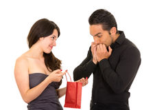Girlfriend surprises boyfriend with a gift Royalty Free Stock Photography