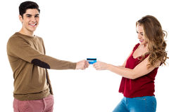 Girlfriend sweetly snatching debit card Stock Image