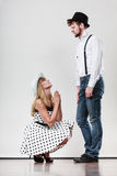 Girlfriend trying to convince boyfriend. Royalty Free Stock Image