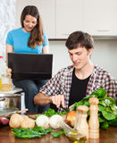 Girlfriend watches recipe on the laptop Royalty Free Stock Image