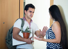 Girlfriend watching man moving out Stock Images