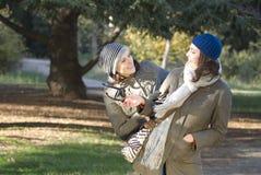 Girlfriends. Two young beautiful women walk on the nature Stock Photos