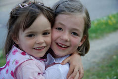 Girlfriends. Two little girls hugging each other Stock Photo